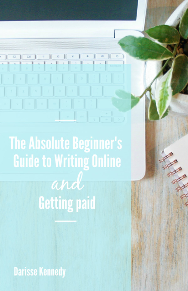 Cover Page for Training Guide titled 'The Absolute Beginner's Guide to Writing Online and Getting Paid' Laptop, plant, and notebook on a table.